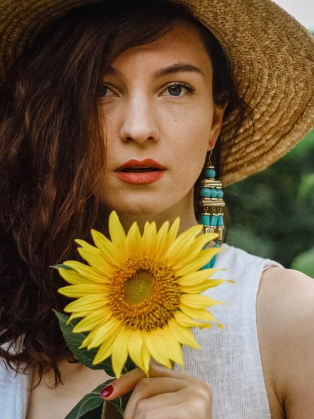 Discover-Chisinau-Moldavia-Portrait-SunFlower Girl-Straw-Hat-drop blue earings