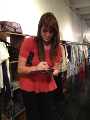 Treana Peake, Obakki founder, autographing her lookbook