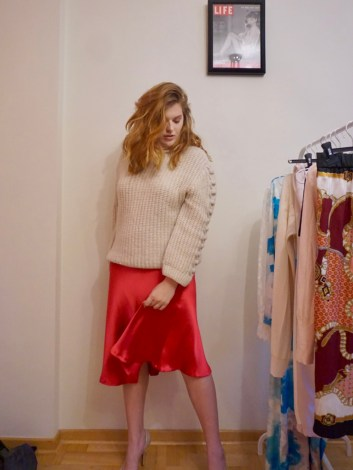 Red satin skirt with chunky knit sweater