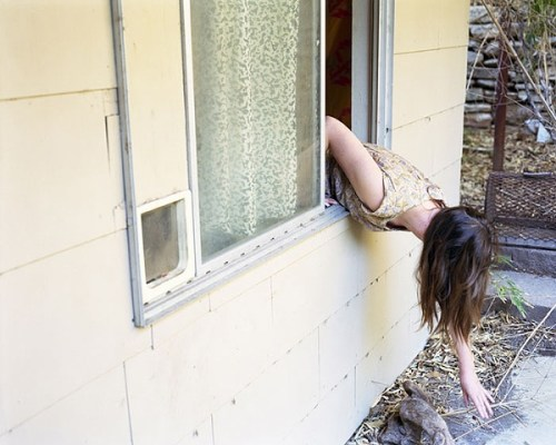 Anastasia-Caabon-leaning-out-window