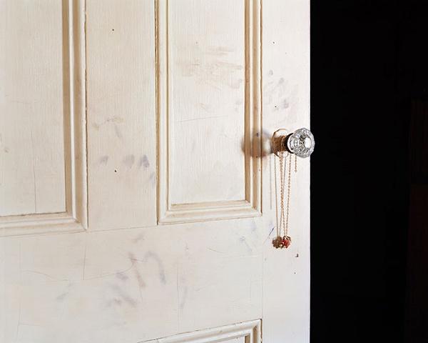 Anastasia-Caabon-necklace-on-doorknob