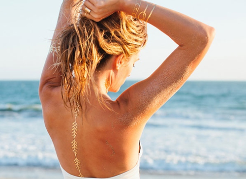 lulu-dk-gold-back-tattoo