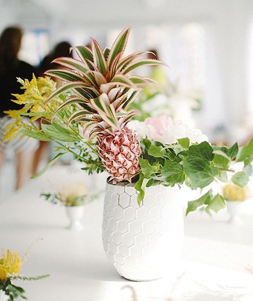 Tropical Centerpiece With Pineapple And Flowers