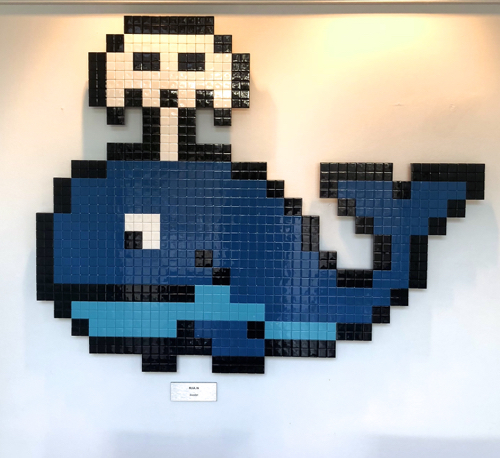 whale with spout by artist know as invader