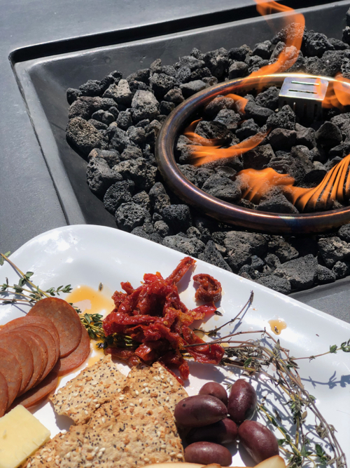 Firepit with cheese platter