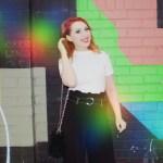 Blogger in Shoreditch with technicolour grafitti wall talking about nostalgia