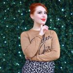 Alice wears Joanie Clothing's golden girl jumper and leopard print skirt for a sparkly festive look