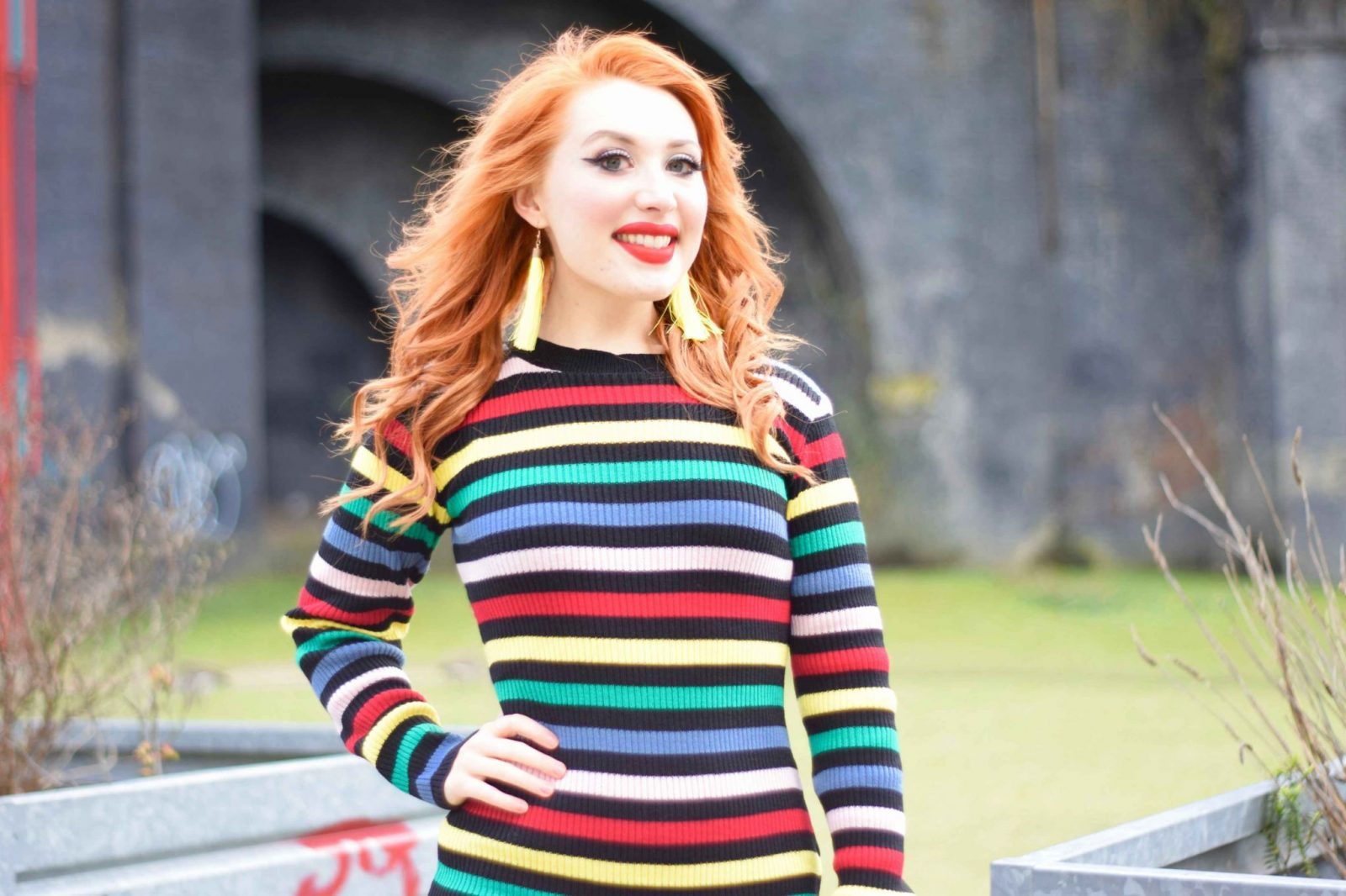 Blogger Twenty-Something City wears rainbow stripe dress