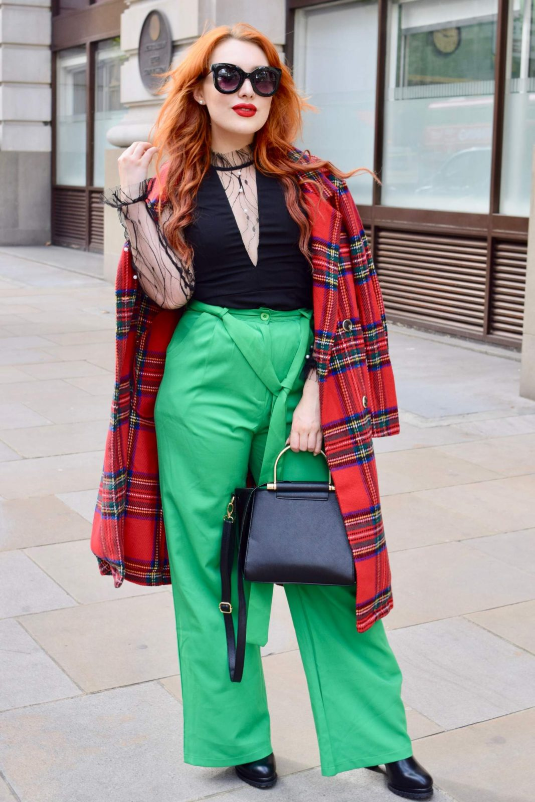 Blogger Twenty-Something City wears red tartan coat at LFW