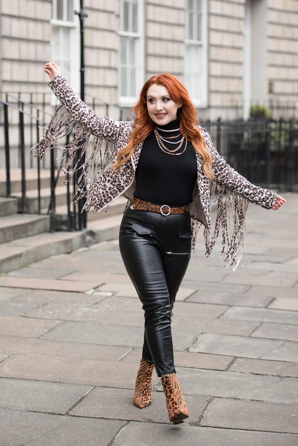 Blogger Twenty-Something City leopard tassel biker jacket