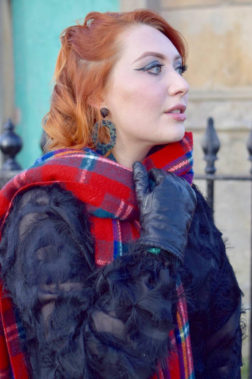 Twenty-Something City cosy winter fashion wearing tartan blanket scarf and statement earrings