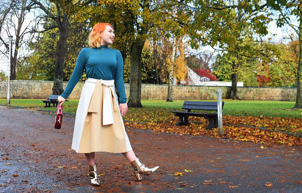 Ethical fashion blogger Alice wears teal tencel top and cream and camel wrap skirt from sustainable brands
