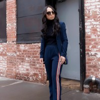 Suit & Stripes: PINKO Blue Crepe Athleisure Suit, Navy Turtleneck, Prada Havana Cat Eye Sunglasses, Blue Prada Camera Bag and Christian Louboutin Breche 100 Black Patent Pumps