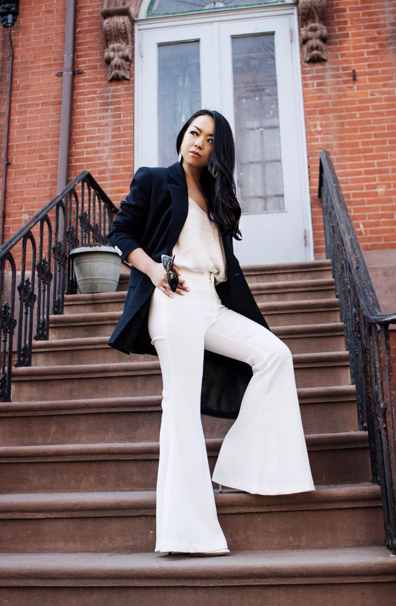 Sophisticated Summer: Blue Double-Breasted Blazer, Cream Silk Camisole, White Exaggerated Bell Bottom Trousers, Silver Stiletto Ankle Boots and Handle Bag