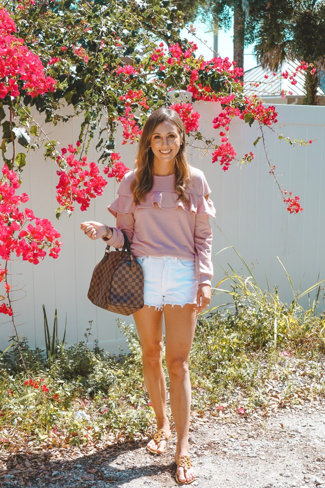 sexy modest boutique pink ruffle sweatshirt with white shorts