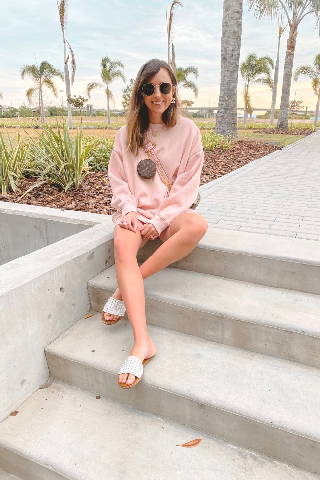 american eagle pink sweatshirt with pink bike shorts and steve madden farryn sandals