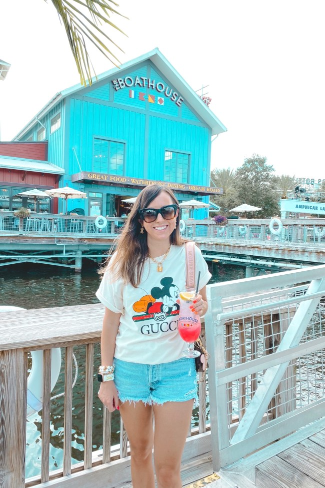 cream gucci disney tee with agolde shorts and louis vuitton multi pochette