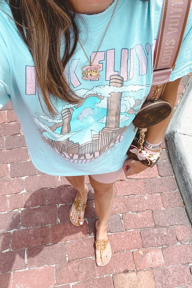 blue pink floyd tee with pink bike shorts and chanel necklace