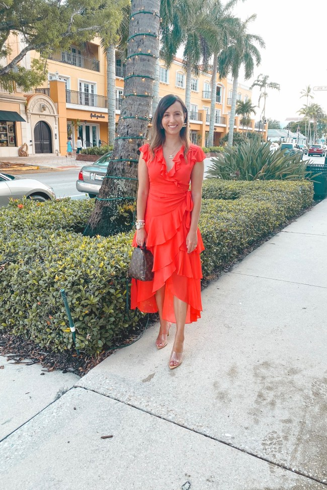 hale bob red dress with clear heels and louis vuitton palm springs
