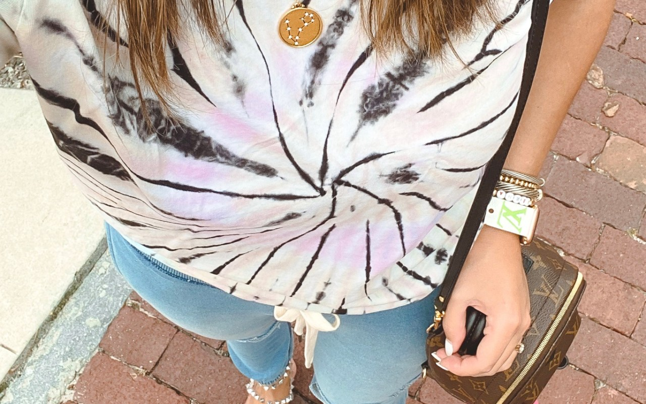 nphilanthropy tie dye tee with sequin jewelry zodiac necklaces and blue joggers