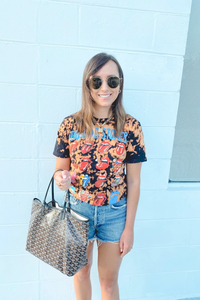 August outfit ideas bleached rolling stones tee with goyard bag and agolde shorts