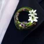 Boutonniere with white ornithogalum and decorative grasses