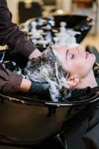 person washing woman s hair