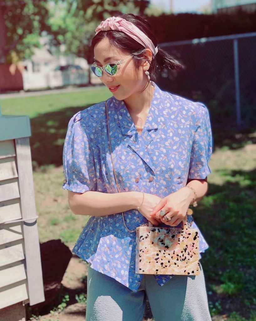 Vintage blue floral top, sunglasses, pink headband, printed handbag, earrings, quarantine