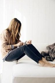 Le-Fashion-Blog-Blogger-Style-Layers-Camel-Knit-Striped-Tshirt-Faded-Black-Raw-Hem-Jeans-Via-Lindsay-Marcella