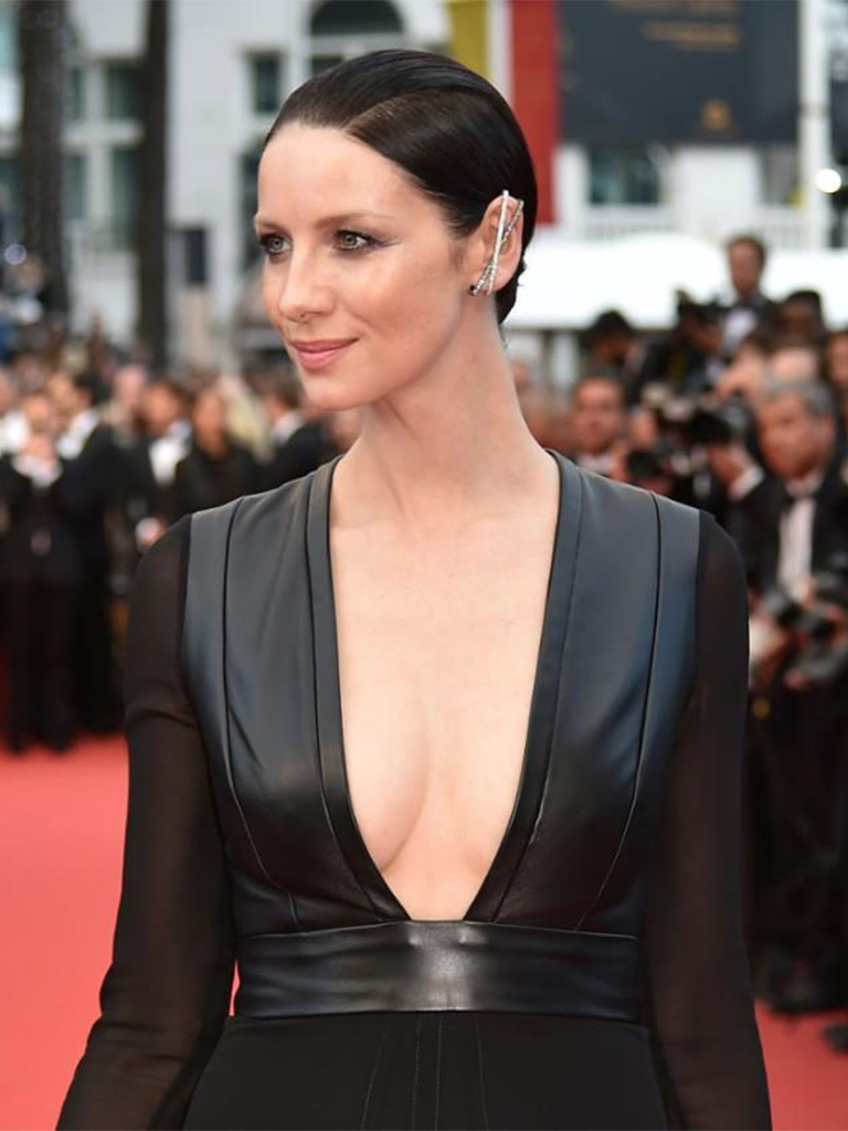 Caitriona Balfe wearing a white and black diamond set in gold, Staple earring by Repossi. PC-The Telegraph