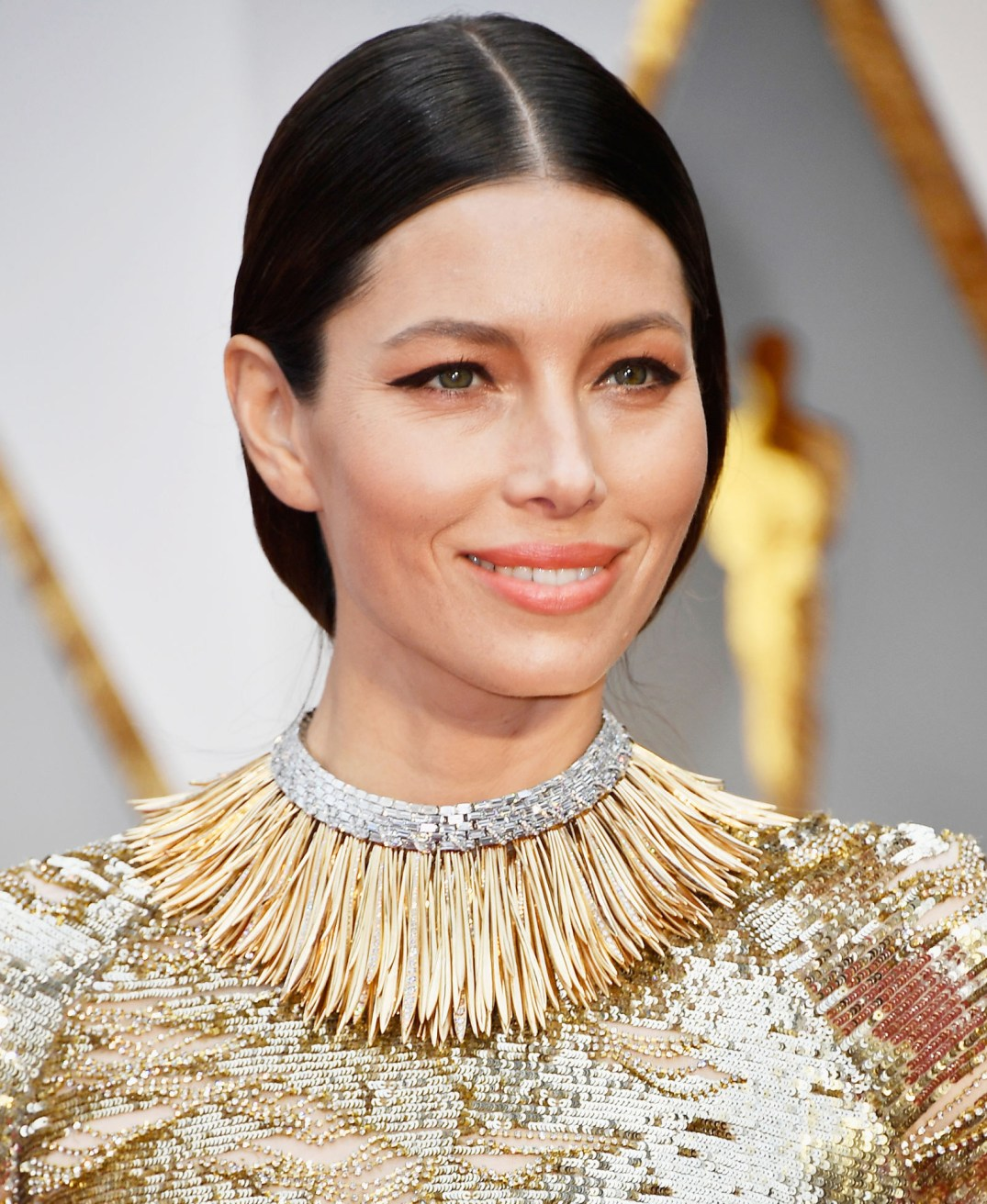 """Jessica Biel wears a handcrafted Tiffany And Co's """"Whisper Of The Rain"""" collar necklace, made using over 350 uniquely shaped 18k yellow gold fronds and over 200 baguette diamonds. The collar is roughly 60 carats. Its from their 2017 Blue Book Collection. PC- Harper's Bazaar"""
