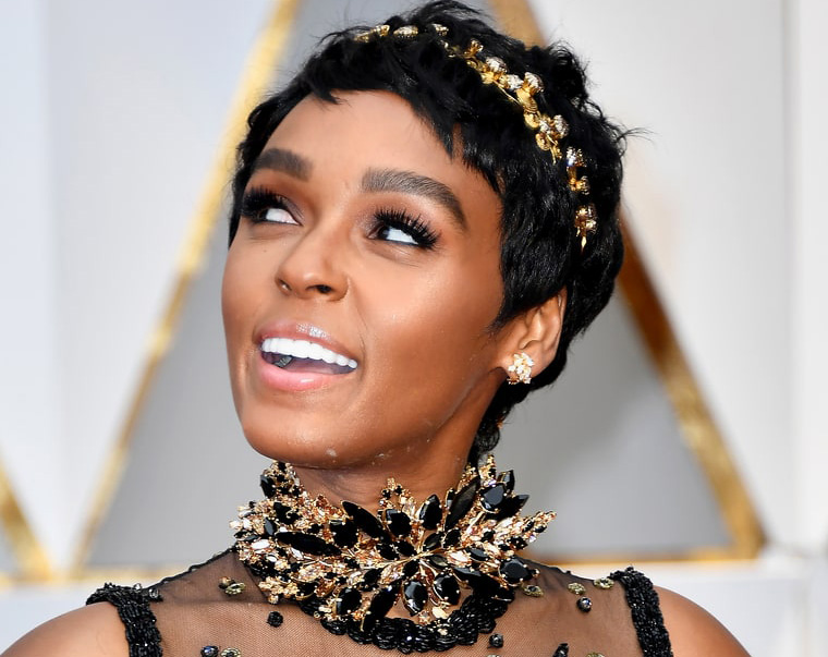 Although I didn't much appreciate the outfit worn by Janelle Monae, but her headband studded with gemstones makes a regal presence and is designed by Jennifer Behr's Artemisa Crown. PC- US Magazine
