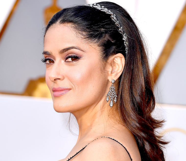 The gorgeous Salma Hayek choses a 19th century diamond laurel leaf headband by Fred Leighton. PC-US Magazine