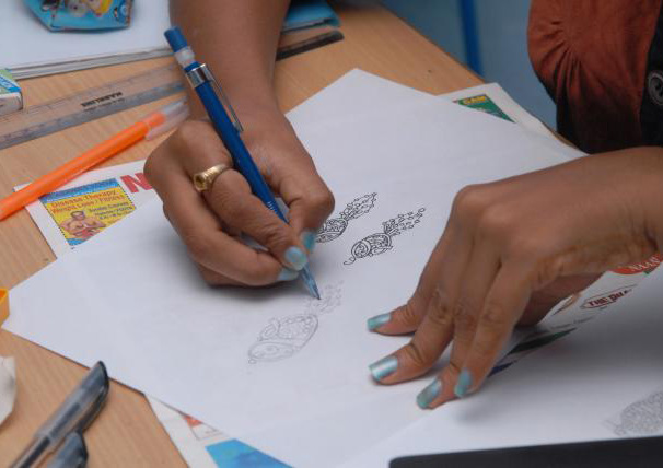 Jewelry Designer Sketching Jewelry. PC-Google