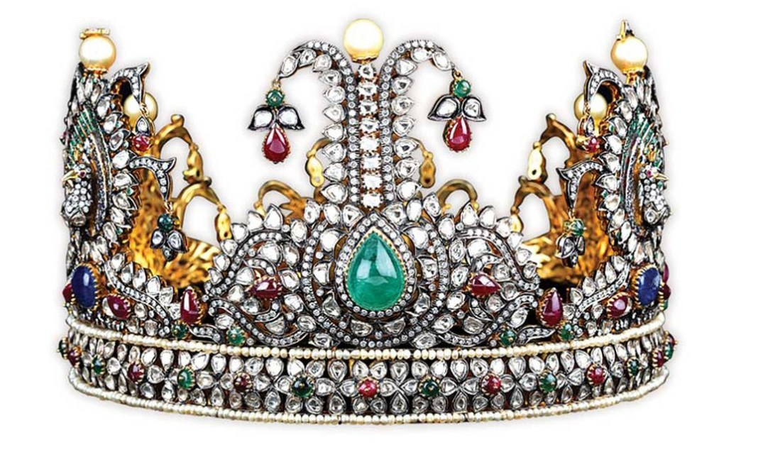 Panch Dhatu Crown Designed For 2010 Miss Universe India Pageant Inspired From The Five Elements Of Nature. The Consort Crown Is Studded With Ruby, Emerald, Sapphire, Pearl And Diamond. Manufactured In 180 Days The Crown Is Studded With Uncut Diamonds (Polki) And Brilliant Cut Diamonds Along With A Composition Of Five Metals And Alloys. PC-Golecha's