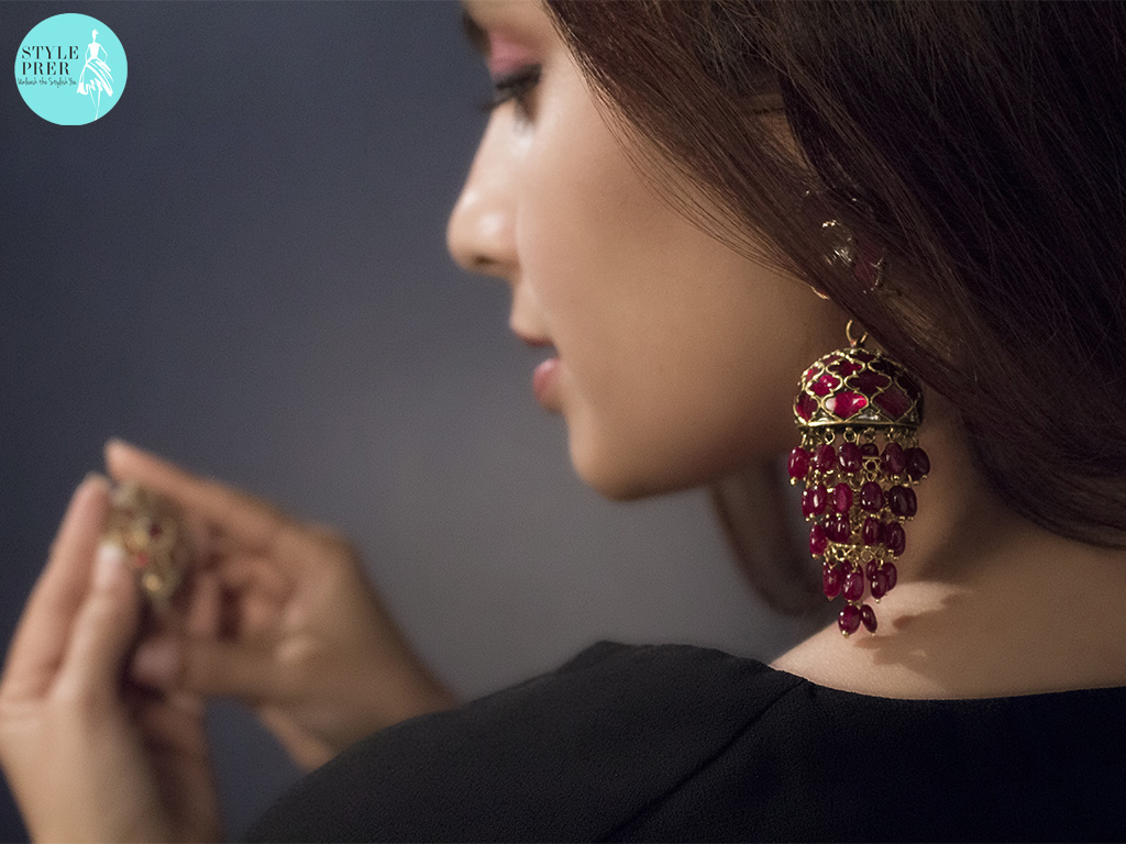 Adorning A Pair Of Gemset Ruby Jhumki Earrings