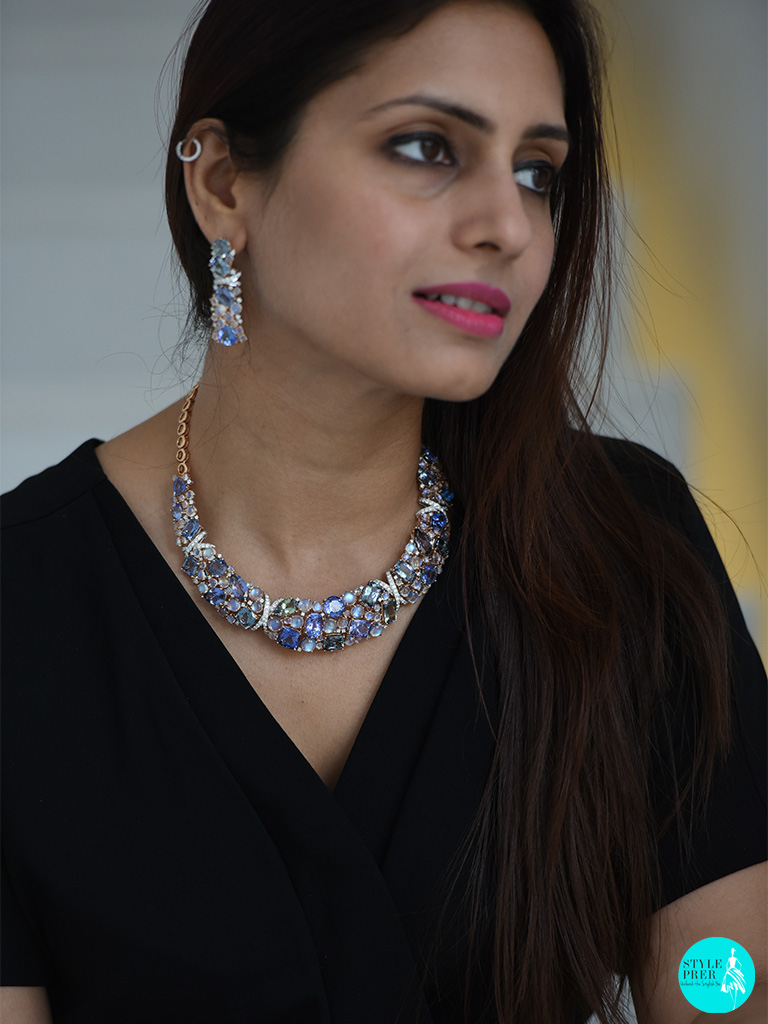 At The Staircase, Wearing Blue Topaz, Aquamarine, Opal, Peridot And Diamond Necklace Set By Gyan Jewels