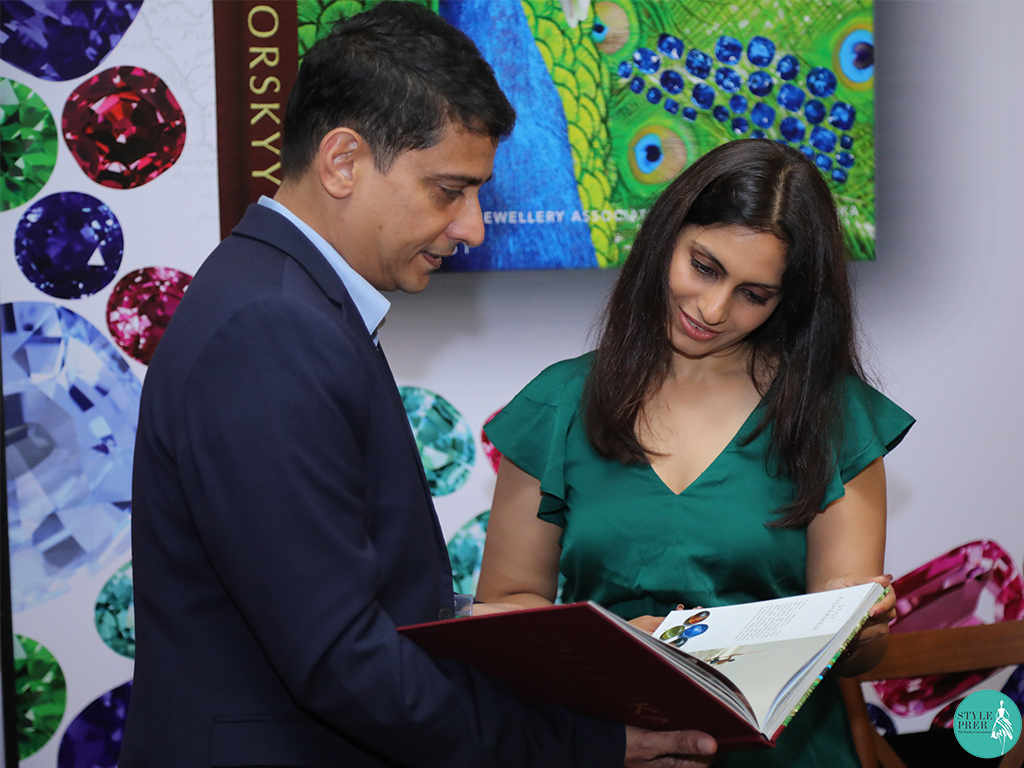 "Mr. Armil Sammoon presents ""Sri Lanka Gems"" to Ms. Prernaa Makhariaa"