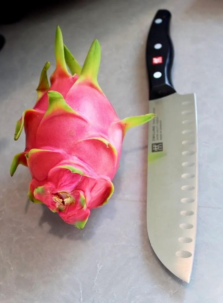 Dragon fruit with knife