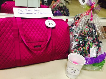The biggest basket auction prize includes a five piece travel bag set and an accompanying basket. Players had to purchase tickets for this one separately.