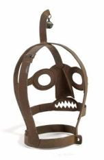 A Belgian Iron 'scold's bridle' or 'branks' mask, with bell, used to publicly humiliate and punish, mainly women, for speaking out against authority, nagging, brawling with neighbours, blaspheming or lying. c.1550-1800.