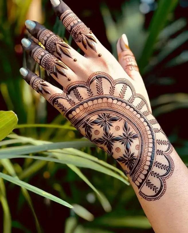 Back Hand Design With Leaf Motifs