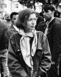 April 1967, Golden Gate Park, San Francisco, California, USA --- Writer Joan Didion walks among hippies during a gathering in Golden Gate Park, San Francisco. --- Image by © Ted Streshinsky/CORBIS