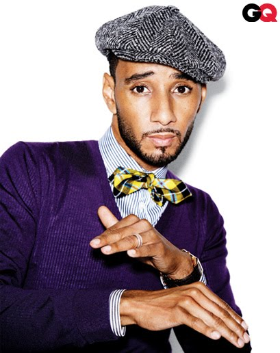 Swizz Beats in a purple sweater, striped shirt and yellow plaid bow tie