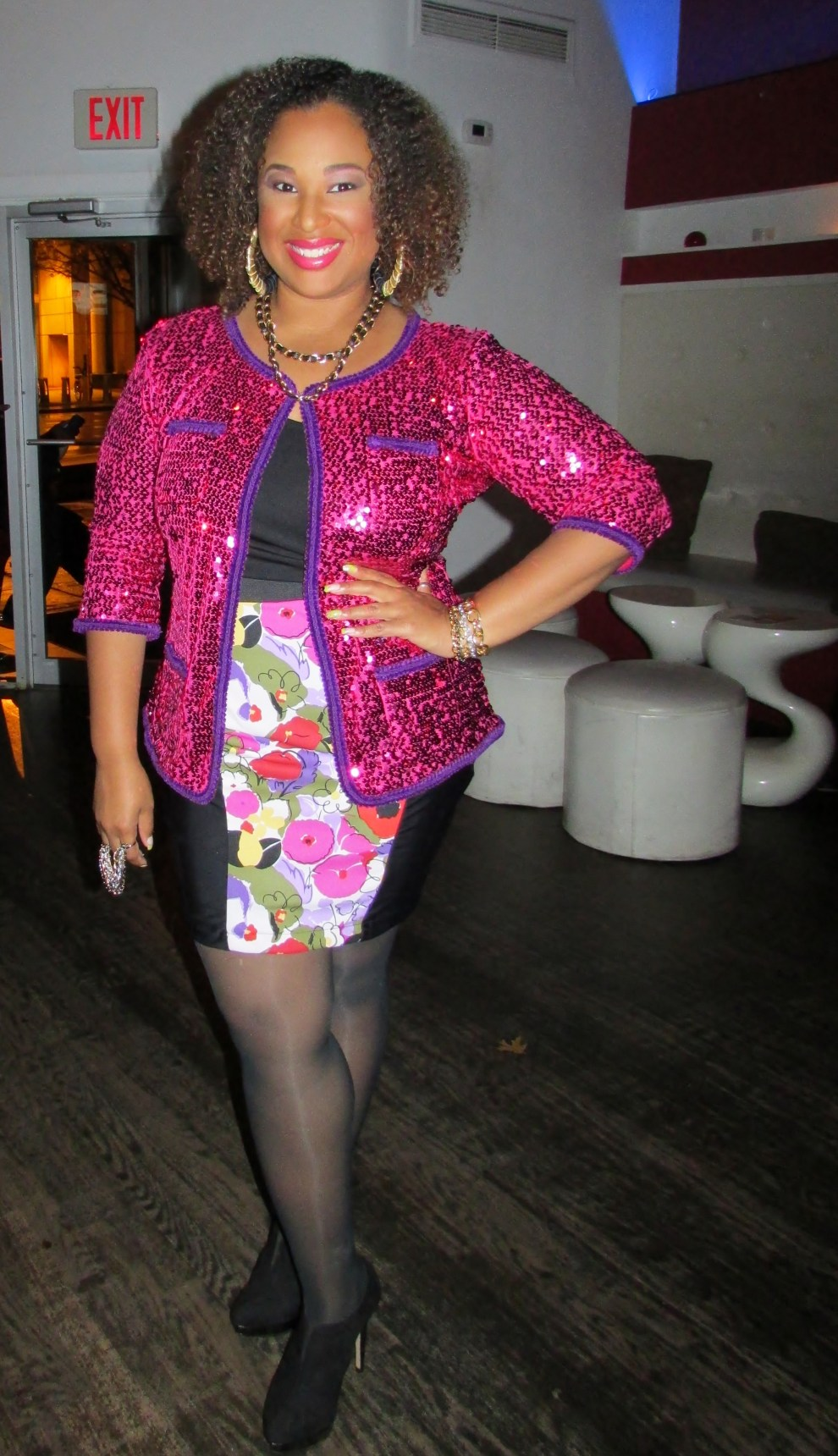 Candice Nicole of Candice Nicole PR,. wearing skirt and jewels by Mdurvwa Collection