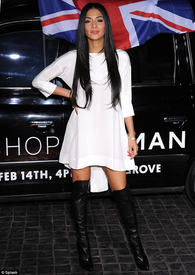Nicole Scherzinger paired hers with a cute white hi-lo shift dress