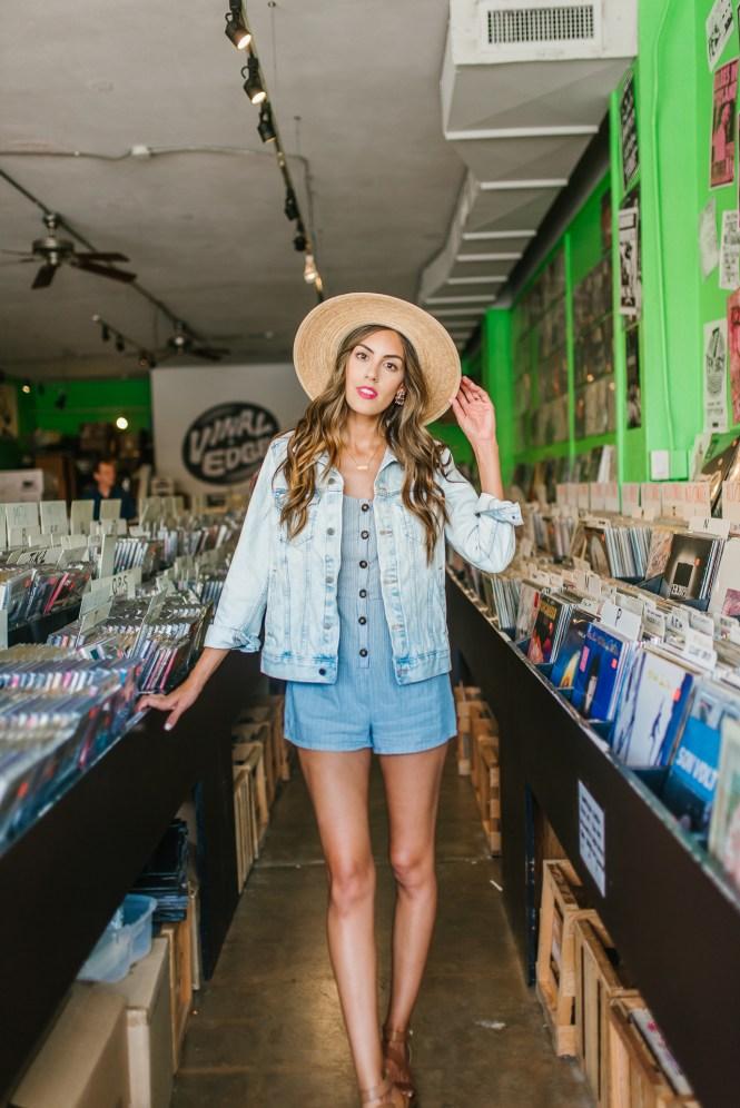 Blue Romper Denim Jacket in vinyl record store
