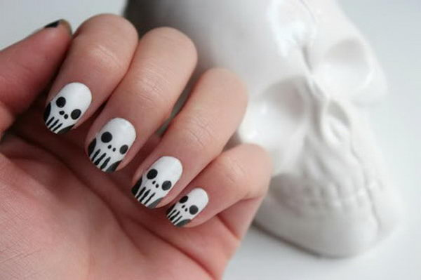9 skull nails - 30 Cool Halloween Nail Art Ideas
