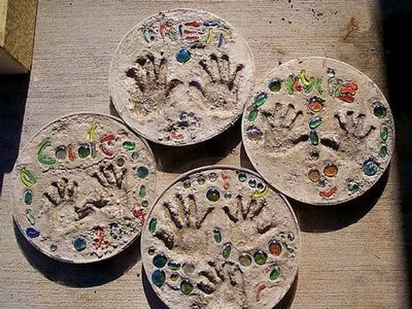 5 stepping stones childs handprint - 20 Cool DIY Concrete Project Ideas