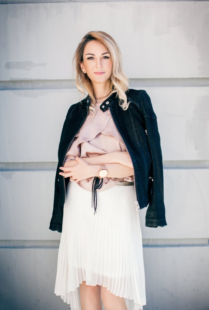 Blush cold shoulder pink satin top white pleated high low skirt black leather jacket and pink satin booties